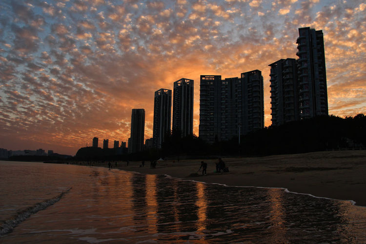 Architecture Beauty In Nature Building Exterior Built Structure City Cityscape Cloud - Sky Day Modern Nature No People Outdoors Sea Sky Skyscraper Sunset Travel Destinations Urban Skyline Water Waterfront Colour Your Horizn