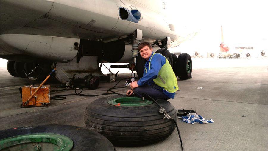 Portrait of man repairing airplane