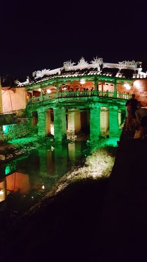 Night No People Architecture Building Exterior History Outdoors Built Structure Water Illuminated War Sky Nature Floating Lanterns Floating On Water Lanterns In A Night Sky My Smartphone Life The Week On EyeEm Beautiful Places In The World Travel Destinations Bridge - Man Made Structure Dragon Bridge