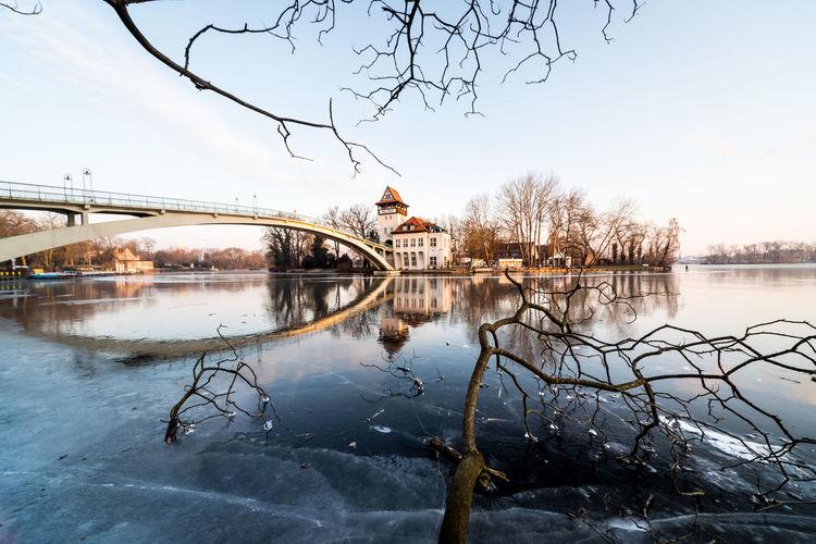 Bridge Over Frozen River During Winter