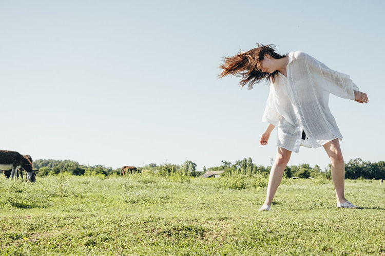 Land Grass Field Sky Leisure Activity Plant Full Length Nature One Person Lifestyles Day Motion Real People Environment Women Casual Clothing Hairstyle Outdoors My Best Photo