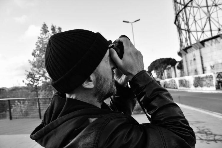Portrait of man wearing hat against sky