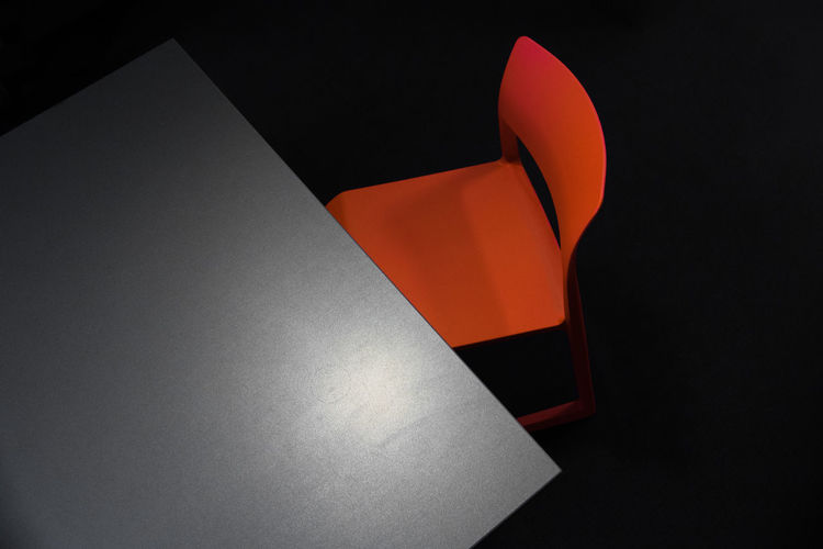 High angle view of table and chair against black background