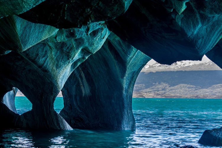 Water Sea Rock Rock Formation Nature Beauty In Nature No People Rock - Object Tranquility Solid Tranquil Scene Waterfront Scenics - Nature Arch Natural Arch Day Non-urban Scene Blue Outdoors Eroded Chile Carretera Autral Rock