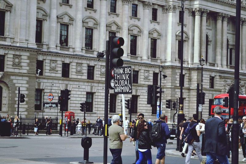 London Old Man Global Warming Think Protest Sign Building Exterior Large Group Of People Real People Street Architecture City Men Built Structure City Street Outdoors Lifestyles Women City Life Day Red Light Crowd Adults Only People Adult