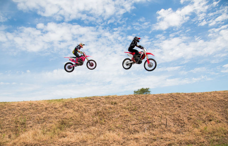 Motocross racers jumping
