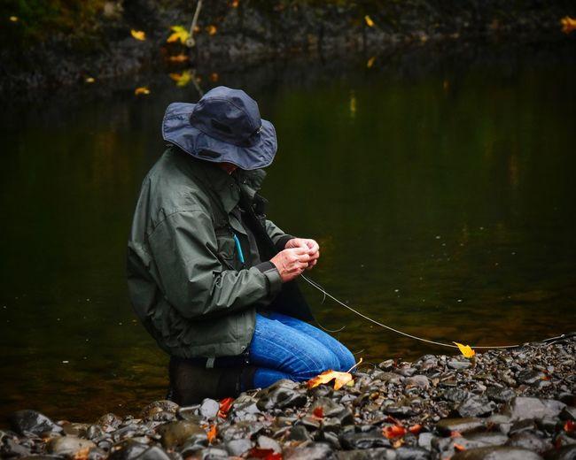 Man fishing on lakeshore