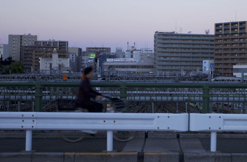 Man and cityscape against clear sky