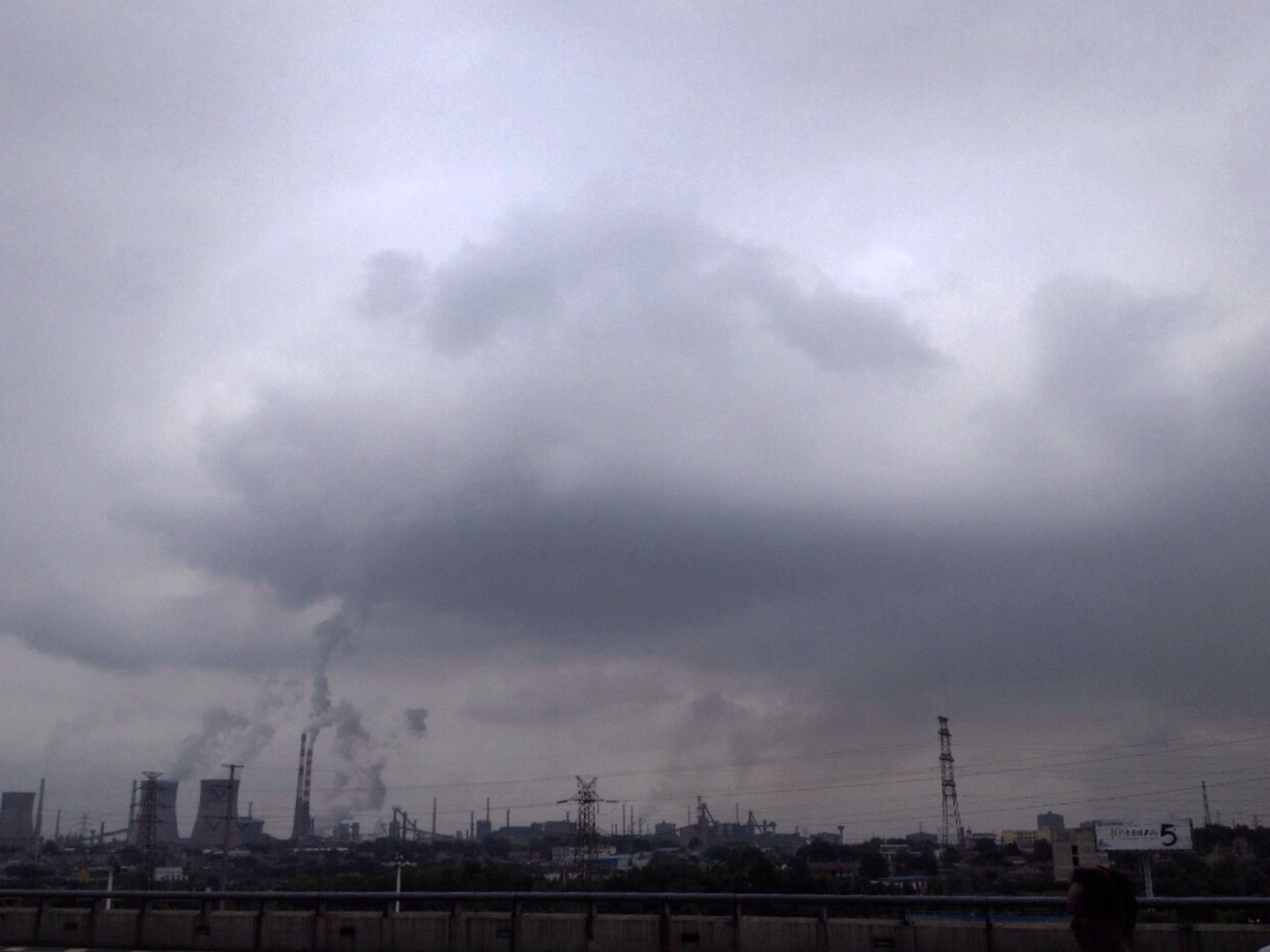 sky, cloud - sky, built structure, architecture, cloudy, building exterior, weather, overcast, city, cloud, development, outdoors, cityscape, dusk, day, no people, storm cloud, nature, connection, industry