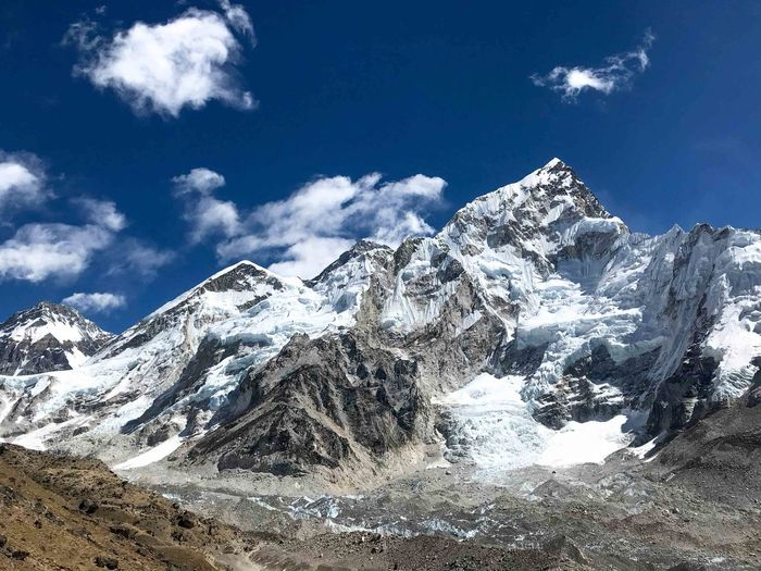 Everest Base Camp Trek Nepal - view of the Everest complex, with Nuptse in the foreground Beauty In Nature Cold Temperature Landscape Mountain Mountain Peak Mountain Range Sky Snow Snowcapped Mountain