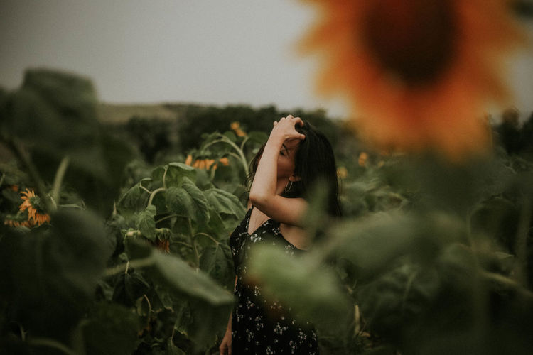 Close-up of woman standing by plants