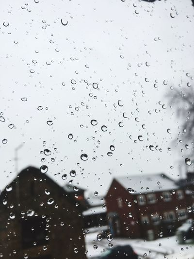 Rain Drop No People Window Wet Water Close-up Indoors  Day RainDrop Architecture Sky Snow Snow ❄ Snowing Houses