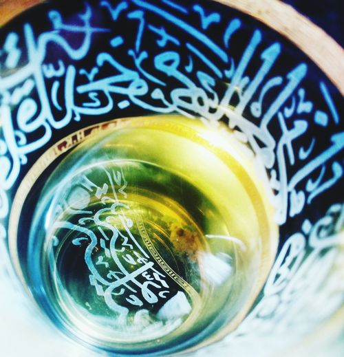 Close-up No People Food And Drink Indoors  Refreshment Freshness Drink Day Multi Colored EyeEm Gallery Art Of Shadow Freshness EyeEm Best Shots Food And Drink Nightphotography Bright Side Of Life Illuminated Relaxation Light And Shadow Arabic Style Arabic Writings Green Tea ❤️ Morrocan Teaglass Art Of Photography Refreshment