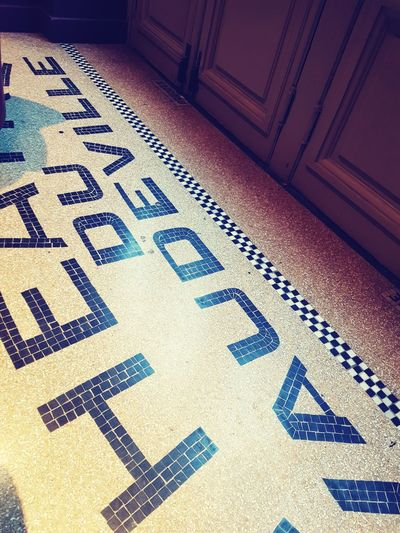 High angle view of text on tiled floor