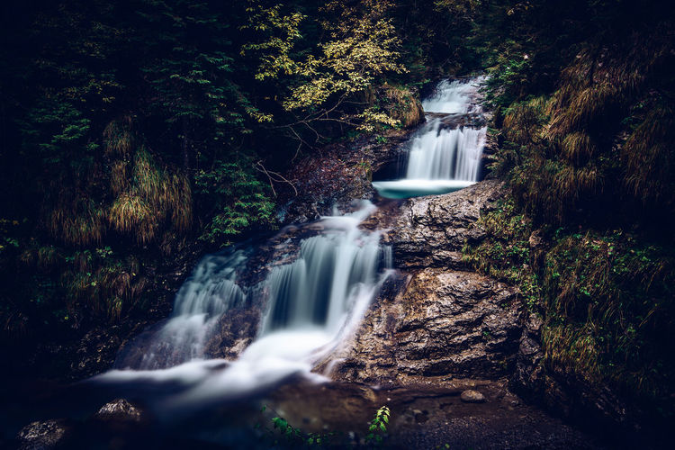 Relaxing flow of water in the enchanted valley italian alps landscape