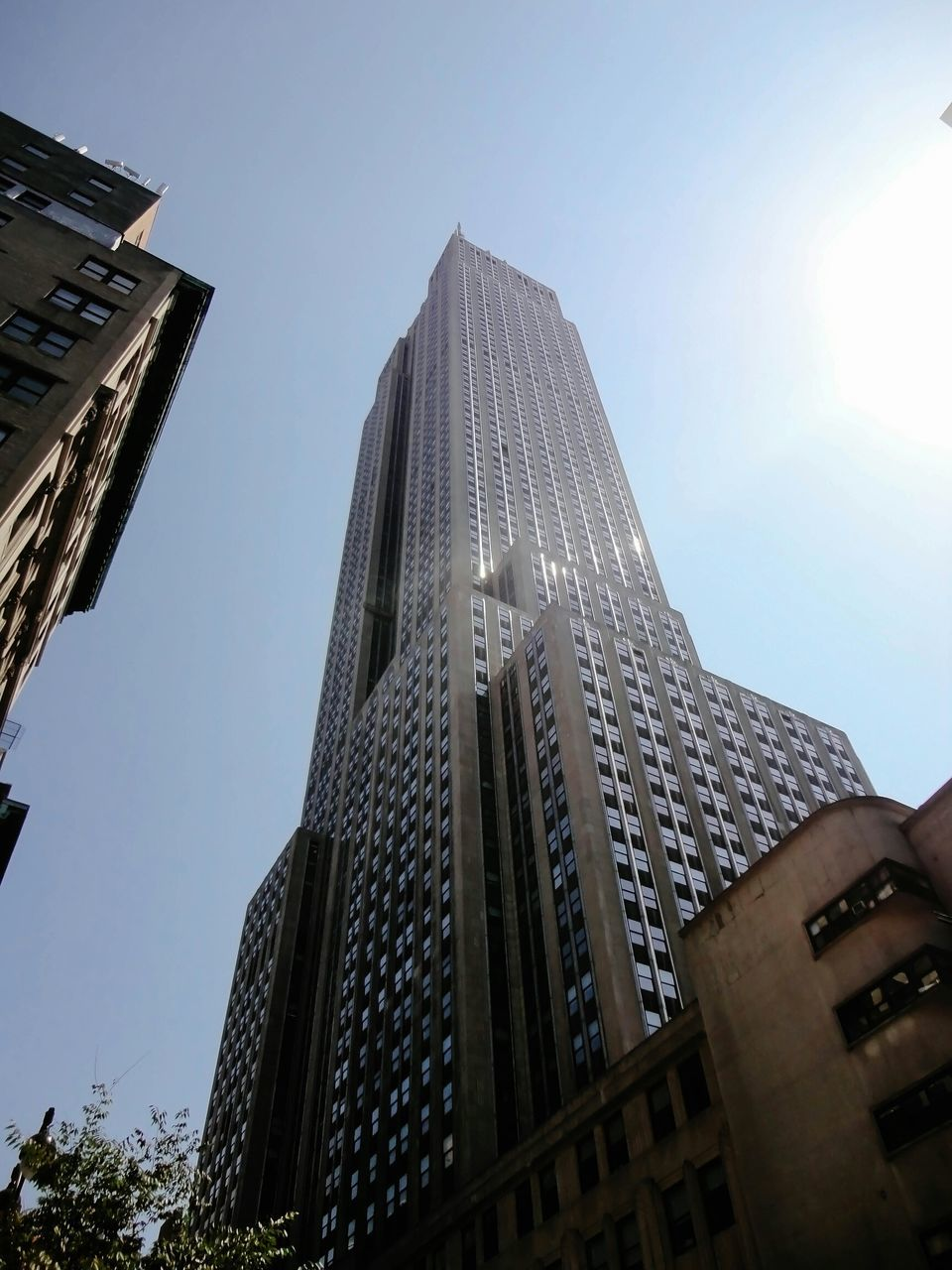 architecture, building exterior, built structure, low angle view, skyscraper, tower, modern, city, day, outdoors, clear sky, travel destinations, sky, no people, sunlight