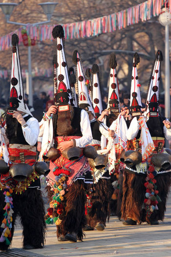 "Kukeri, mummers perform rituals with costumes and big bells, intended to scare away evil spirits during the international festival of masquerade games ""Surva"" in Pernik, Bulgaria – Jan27,2018. Folklore. Bell Dance Evil Fun KuKer Kukeri Kukeri, Bulgaria Mummers Mummers Play Music Bells Colorful Contests Costumes International Landmark Joy Kukerta Lent Mask Masquerade Mumer Mummers Parade Play Scare Spirits"