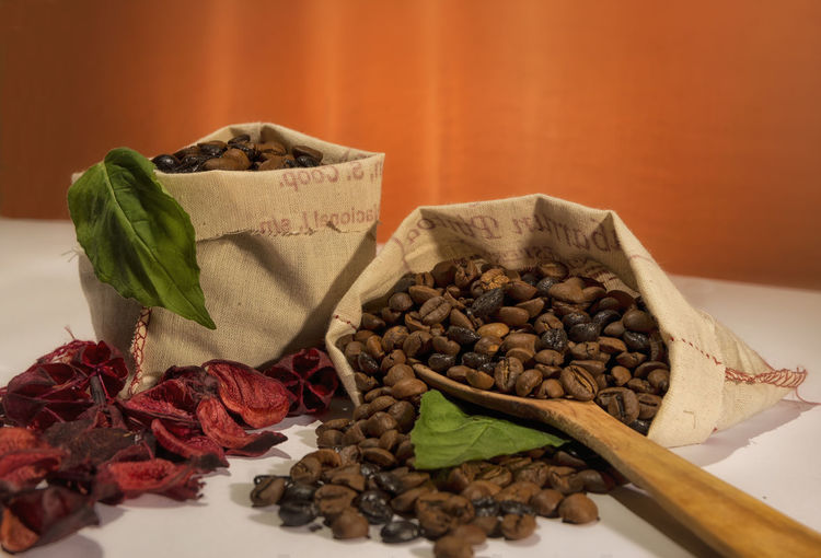 Coffee Grains Close-up Coffee Coffee Time Day Dried Food Food Food And Drink Freshness Grains Green Healthy Eating Indoors  Ingredient No People Orange Still Life White Wood