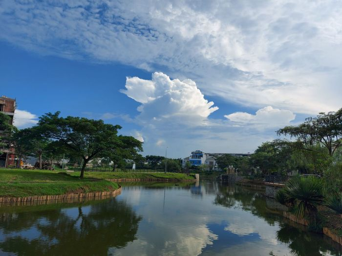 Scenic view of lake by building against sky