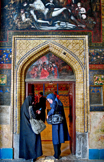 Religion Adult Belief Spirituality Place Of Worship Women Two People Standing Architecture People Real People Arch Entrance Men Clothing Building Exterior Built Structure Communication Lifestyles Art And Craft Couple - Relationship Mural Ornate