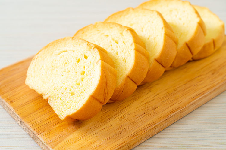 Close-up of bread on cutting board