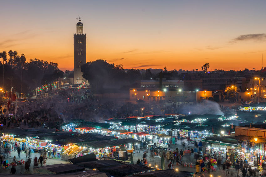 Bustling Marrakesh EyeEm City Shots Marrakesh Morocco Architecture Building Exterior Built Structure City Cityscape Crowd Illuminated Large Group Of People Nature Night Outdoors People Sky Sunset Travel Destinations