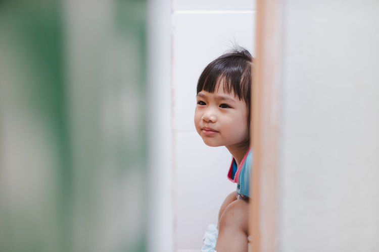 Child Childhood Contemplation Cute Females Girls Hair Hairstyle Headshot Human Face Indoors  Innocence Leisure Activity Lifestyles Looking Looking Away One Person Portrait Real People Selective Focus Window