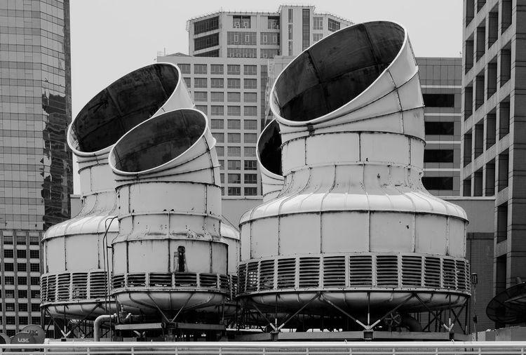 Cooling towers against office buildings in city