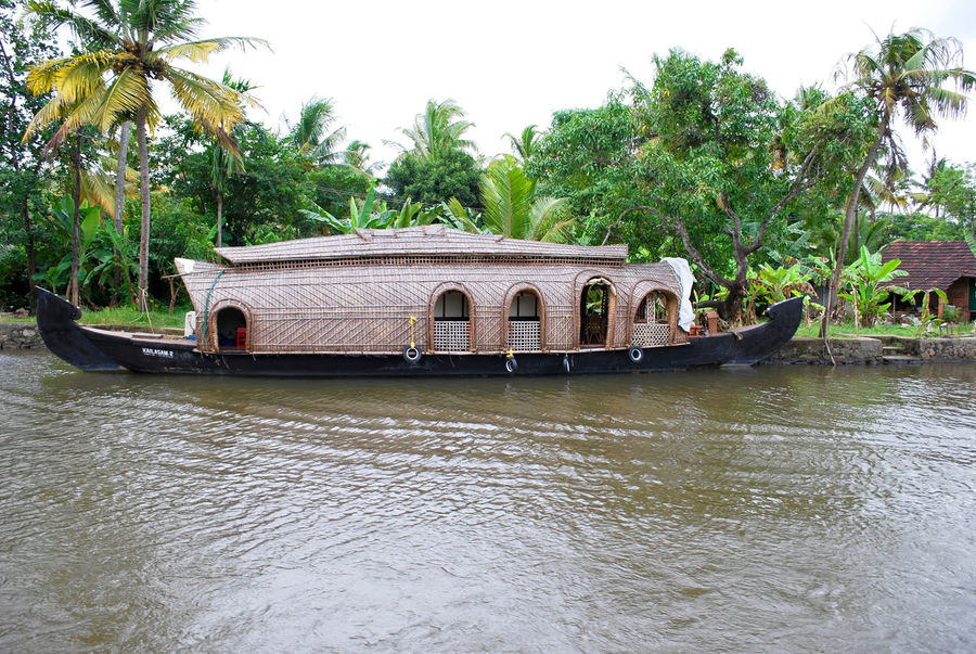 Beauty In Nature Boat Coconut Trees Day Floating Floating On Water Green House Boat Lake Lake View Nature Jeemals Non-urban Scene Outdoors Palm Trees Rippled Scenics Sky Tranquil Scene Tranquility Tree Tree Water Water Reflections Waterfront