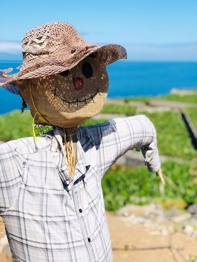Full length of girl wearing hat against sea