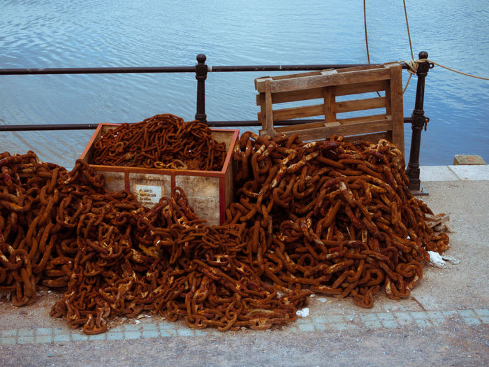 Rusty Chains on a Quayside Chains Day Nature No People Outdoors Quay Quay Side Quayside Railings Rust Rusty Sea Water