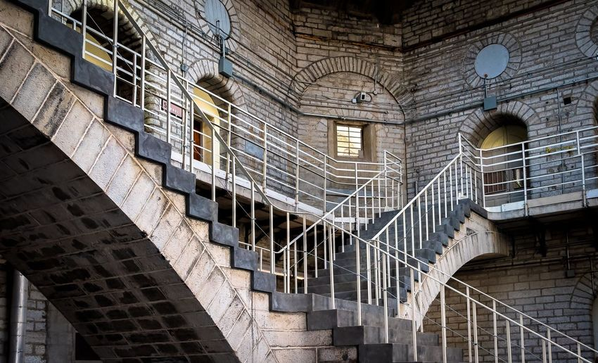 Inside the pen Architecture Penitentiary Built Structure Staircase No People Prison Escher Like Escherish Limestone Indoors  History Somewheremagazine EyeEmNewHere The Week On EyeEm Justgoshoot Artofvisuals Shapes And Forms Prison Museum EyeEm Best Shots Tour Kingston Pen What I See Leicacamera Limestone Walls Historic EyeEmNewHere