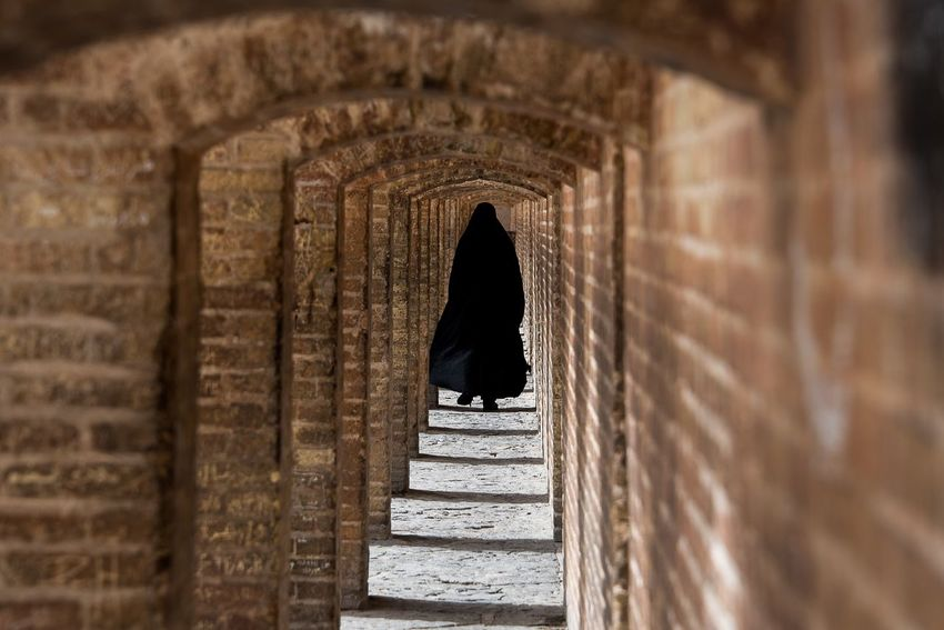 Iranian woman walking Architecture Built Structure Arch History The Past Day The Street Photographer - 2018 EyeEm Awards Real People One Person Door Doorway The Way Forward