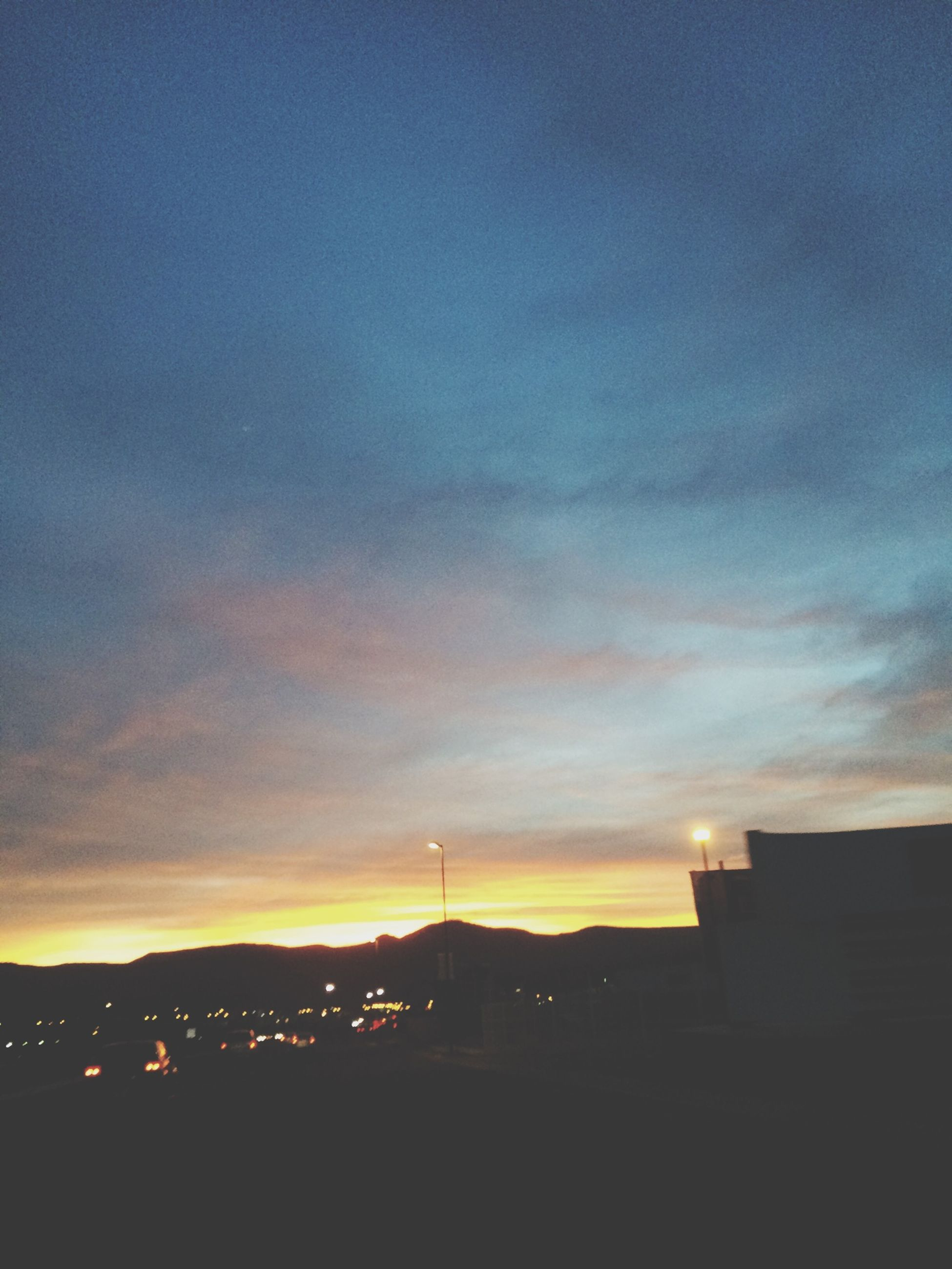 building exterior, architecture, built structure, sunset, silhouette, sky, city, cloud - sky, illuminated, dusk, residential structure, residential building, dark, building, orange color, cloud, house, outdoors, cityscape, no people
