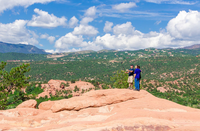 Garden of the gods Beauty In Nature Carefree Casual Clothing Cliff Cloud - Sky Full Length Getting Away From It All Leisure Activity Lifestyles Men Mountain Nature On Top Of Person Physical Geography Rear View Rock - Object Scenics Sky Standing Tourism Tourist Tranquil Scene Tranquility Vacations