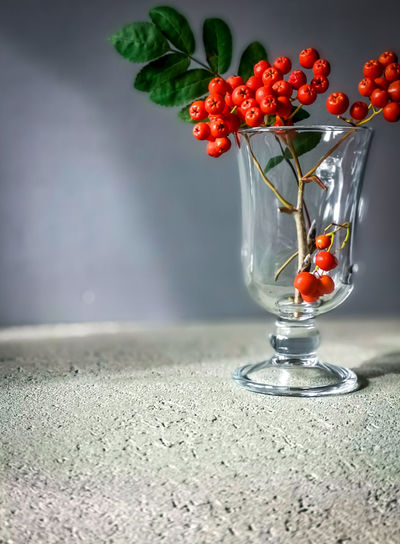 Red berries on glass table