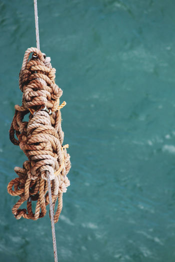 Close-up of rope tied to boat in sea