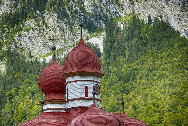 High section of st bartholomew church against mountain