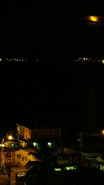 La luna sobre el lago Architecture Building Exterior Built Structure City Cityscape Illuminated Lago De Maracaibo Night No People Outdoors Residential Building Sky