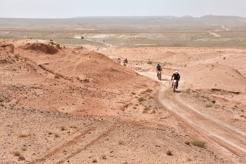 Men Riding Motorbike On Landscape