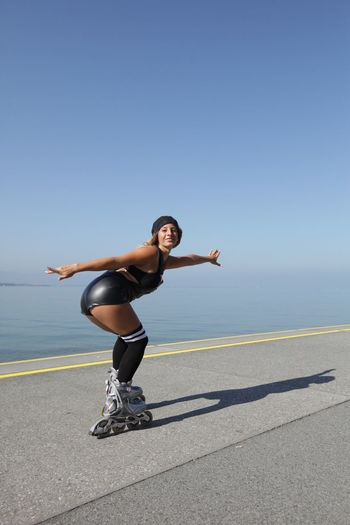 rollerskating woman Roller Blade Blue Clear Sky Day Exercising Full Length Leisure Activity Lifestyles Nature One Person Outdoors People Real People Rollerblading Rollerskating Sea Shadow Skate Skating Sky Sunlight Water Young Adult Young Women