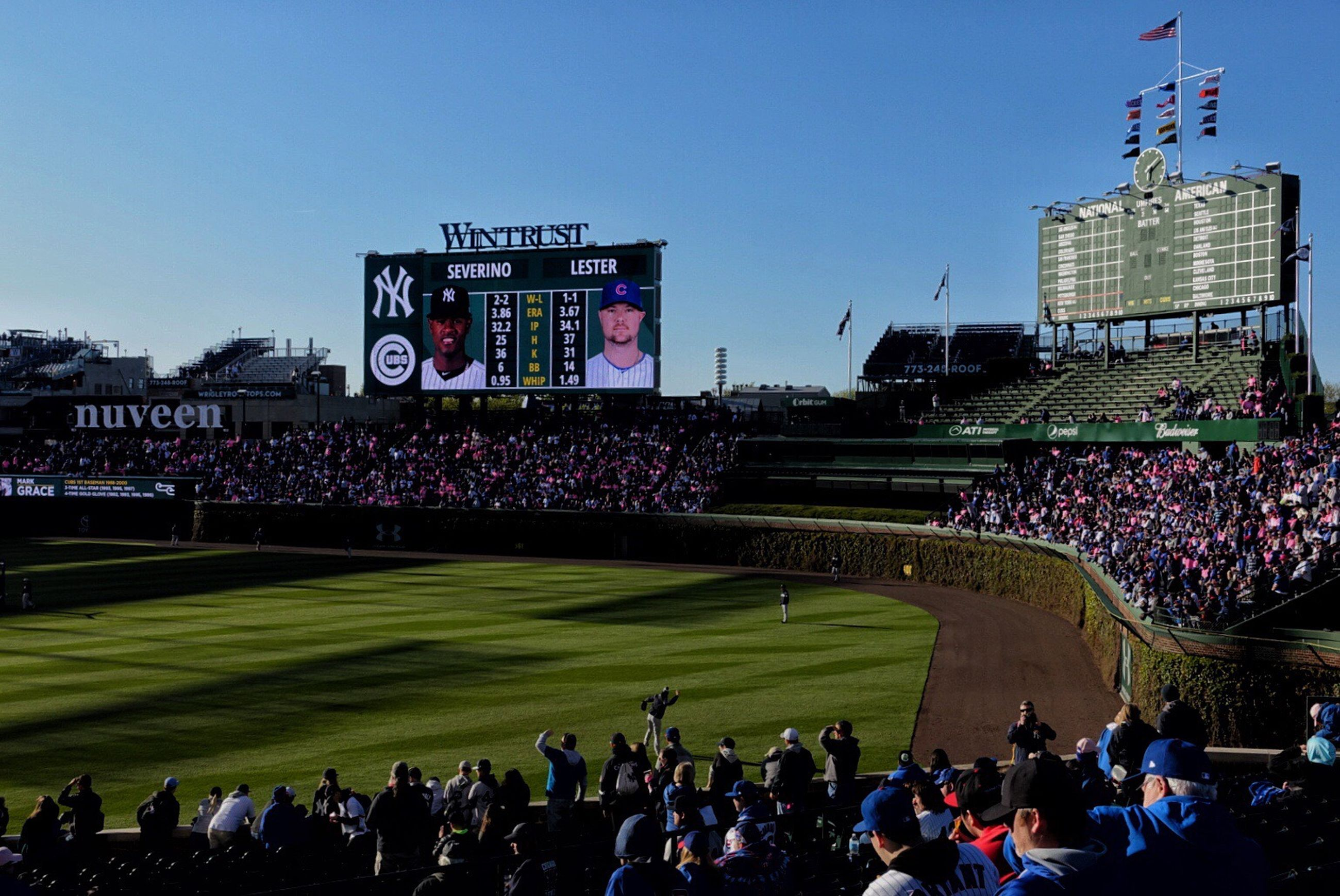 large group of people, crowd, stadium, real people, sport, men, spectator, leisure activity, watching, lifestyles, outdoors, day, baseball - sport, playing, clear sky, audience, built structure, fan - enthusiast, architecture, grass, sportsman, sky, people, adult, adults only