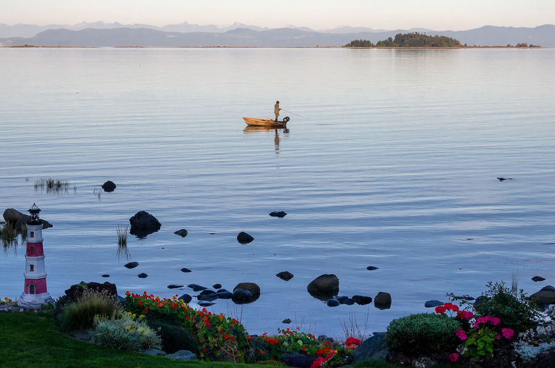 Evening Fishing at Craigdaroch Beach Water Beauty In Nature Plant Transportation Mode Of Transportation Nature Lake Nautical Vessel Scenics - Nature Day Sky Tranquility Tranquil Scene Flowering Plant Flower Idyllic Mountain Outdoors Fishing Baynes Sound Salish Sea