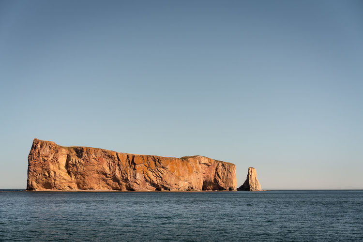 The EyeEm Collection Premium Collection Percé Rock Sea Sky Water Waterfront Scenics - Nature Clear Sky Beauty In Nature Copy Space Tranquil Scene Tranquility Rock Nature Rock Formation Blue No People Horizon Cliff Rock - Object Horizon Over Water Stack Rock Eroded