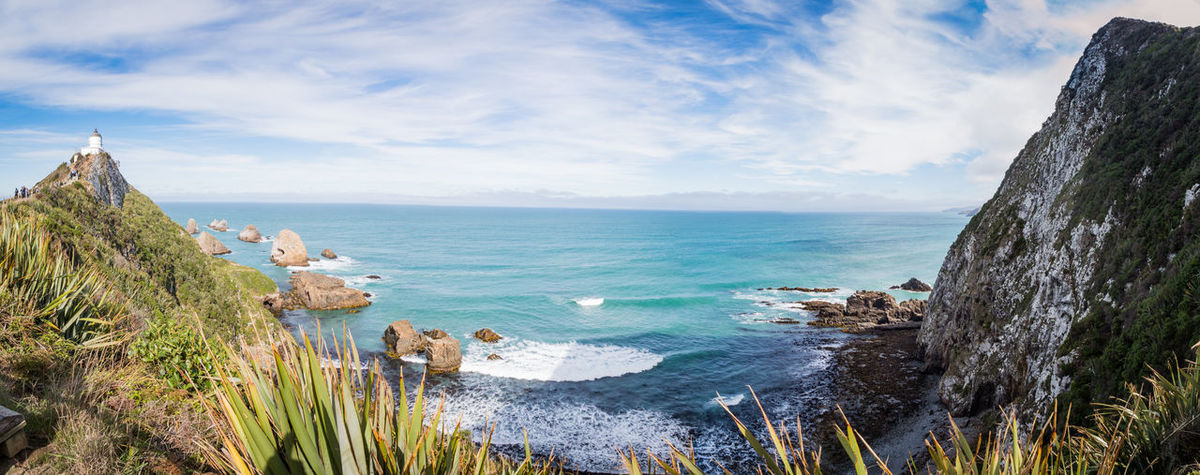 bay cliffs and the lighthouse of nugget point on a bright evening Cliffs Copy Space Nugget Point Lighthouse Panorama Bay Beauty In Nature Cloud - Sky Day Horizon Horizon Over Water Land Nature New Zealand No People Outdoors Panoramic Plant Rock Rock - Object Scenics - Nature Sea Sky Tranquil Scene Tranquility Water The Great Outdoors - 2018 EyeEm Awards