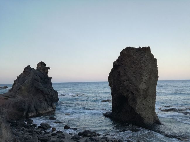 Day Sunset Wave Outdoors Rock Sky Beach No People Tranquility Clear Sky Scenics Nature Rock Formation Water Horizon Over Water Beauty In Nature Rock - Object Sea