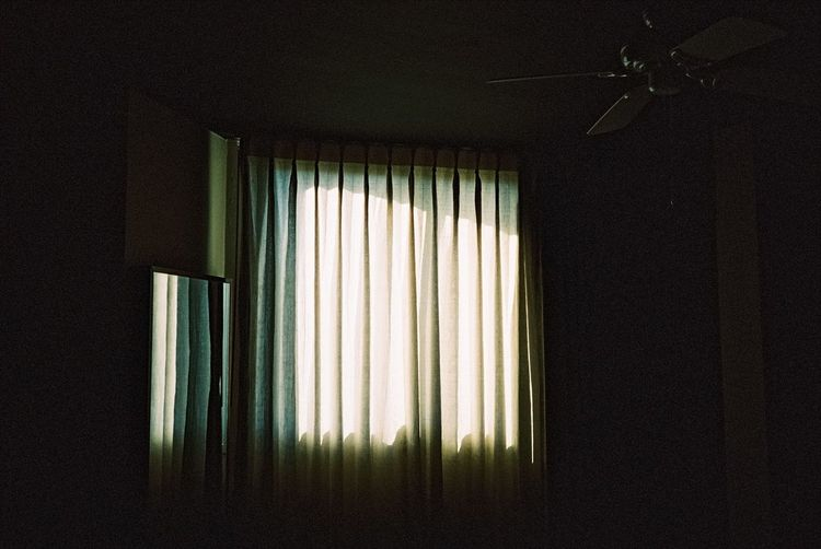 View of curtain hanging from window