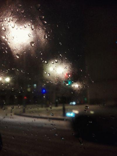 City street seen through wet glass window