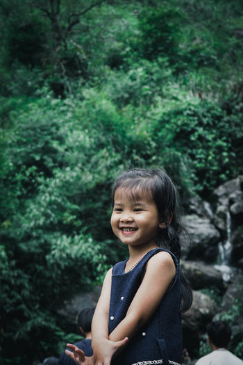 A girl is smiling with happiness Happiness Happy Casual Clothing Child Childhood Cute Day Emotion Enjoying Life Girl Hairstyle Innocence Leisure Activity Lifestyles Nature One Person Outdoors Plant Portrait Real People Smiling Tree Women