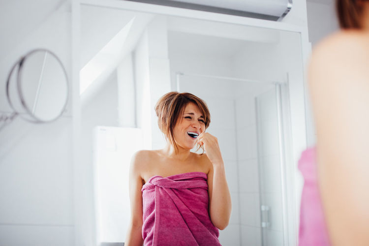 Bathroom Brushing Lifestyles Only Women Portrait Smiling Standing Teeth Toothbrush Young Women